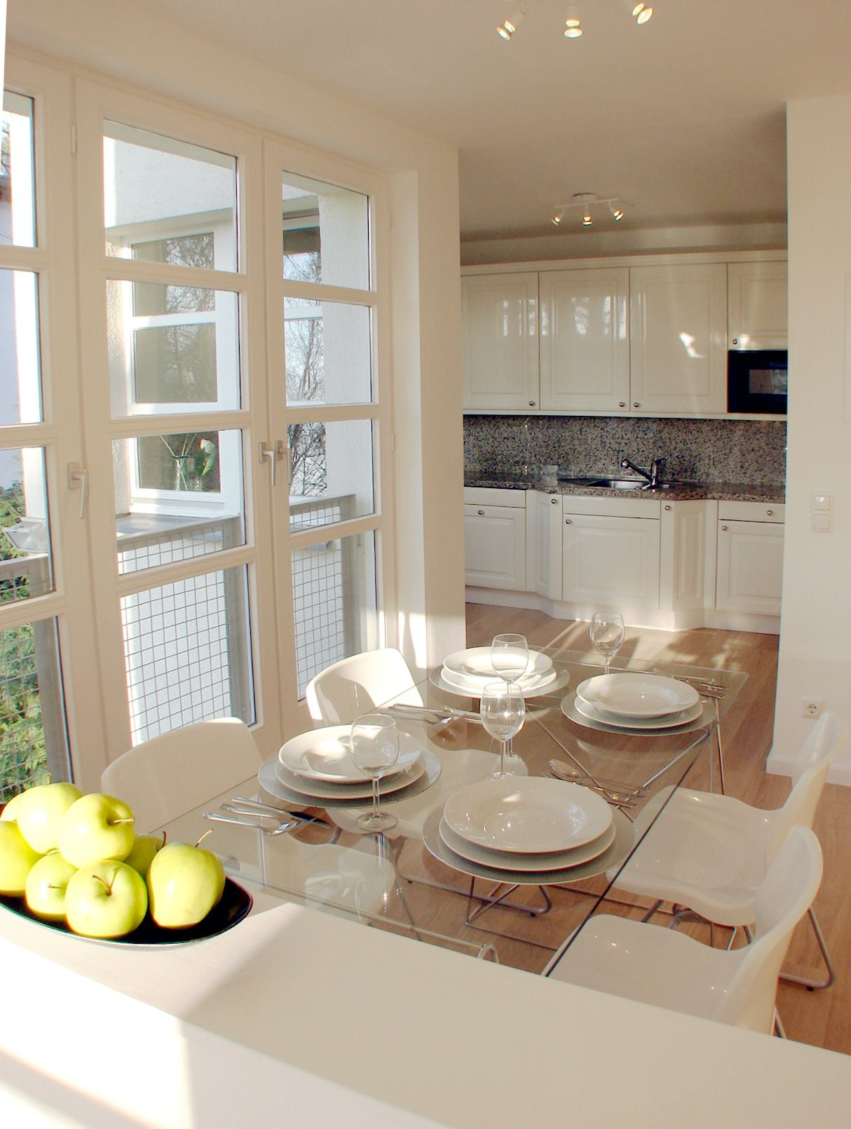 Home Staging Berlin light bright fresh and clean simple table settings and a bowl of