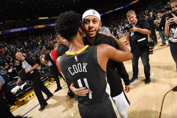 426bc62c052 Quinn Cook of the Golden State Warriors and Seth Curry of the Portland  Trail Blazers exchange a hug after the game on November 23 2018 at ORACLE.