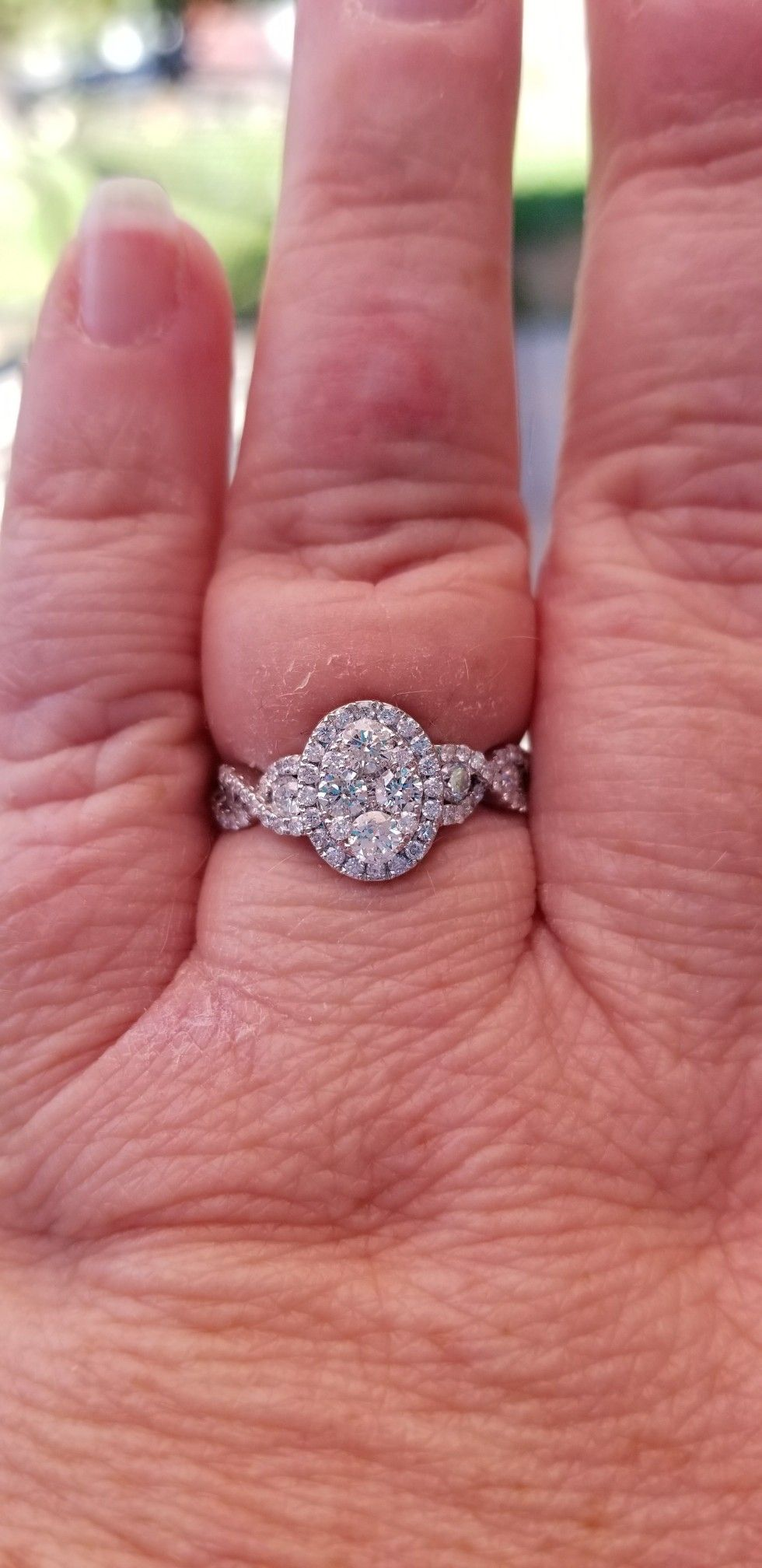 1.10 ct., color f diamond, oval cluster ring set in white gold. I\'m ...