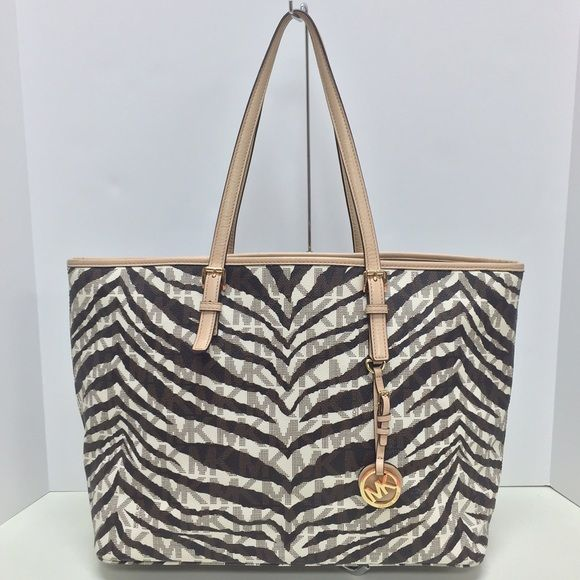 a553a0b1e779 MICHAEL KORS Zebra Tote Authentic Michael Kors zebra print tote. Great  condition. Michael Kors Bags Totes
