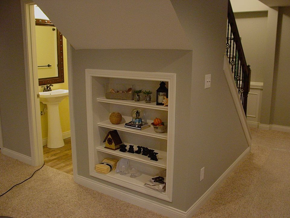 Bookshelves Under Stairs small built in bookshelf under stair area of a finished basement