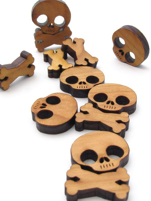 """This Etsy store has some truly fun items..ghosts and skulls and so much more! Check them out>>>    TimberGreenWoods      Sustainable, eco friendly gift ideas for green living.  """"Halloween Mini Skull and Cross Bones Charms - Itsies - Laser Cut Wood Skull and Bones - Free Shipping - TagT Team . Timber Green Woods"""""""