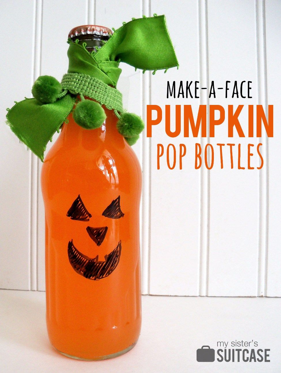 Party guests use markers to decorate their own pumpkin pop bottles! #dryerase #halloween # pumpkin www.sisterssuitcaseblog.com