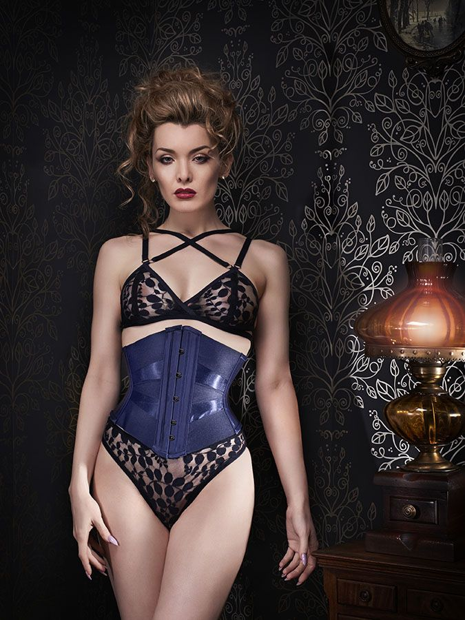 1c59b327c41 This sleek ribbon corset pairs matte and glossy textures. By Orchid Corsetry