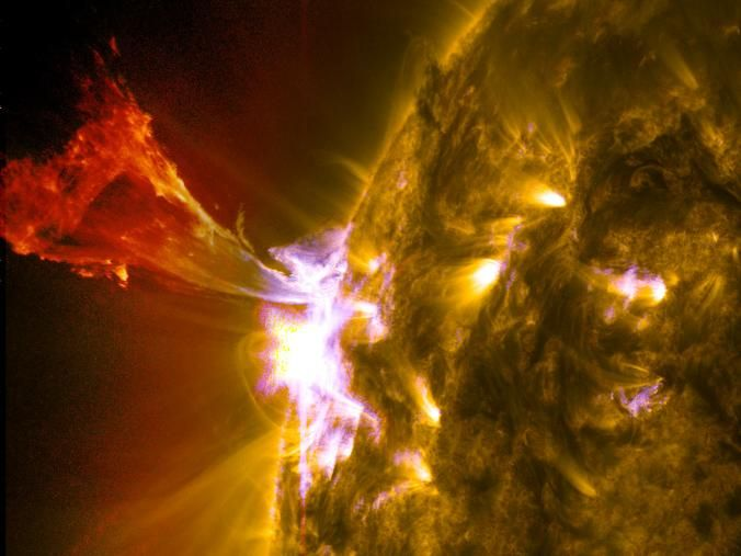Solar Burst - Solar material dances on the sun in this image of a mid-level flare from NASA's Solar Dynamics Observatory taken May 3. nationalgeographic.com