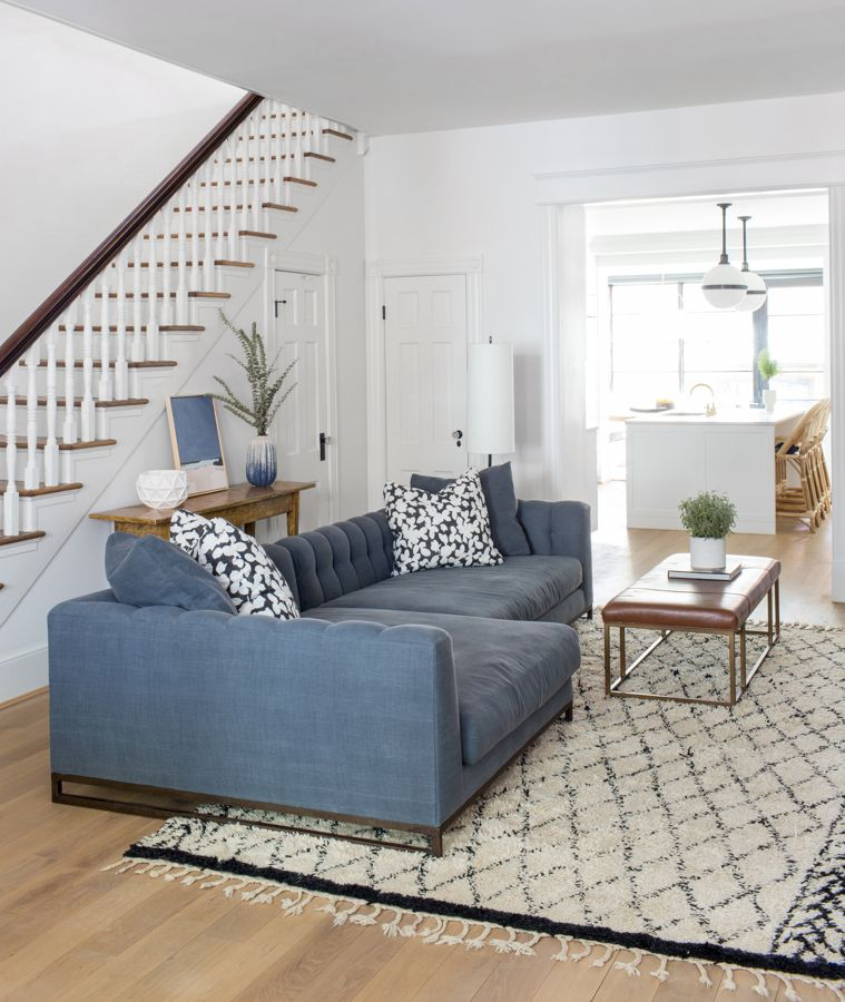 Denim Color Sofa Neutral Moroccan Rug Leather And Metal Coffee Table Open Floor Plan Into K Living Room Floor Plans Living Room Flooring Blue Living Room