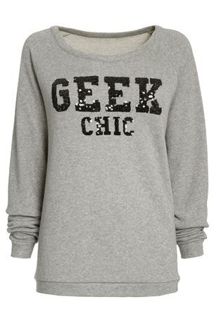 Geek Chic Sweater from the Next UK online shop.  Glittery grey fabric with 'GEEK CHIC' in black sequins.