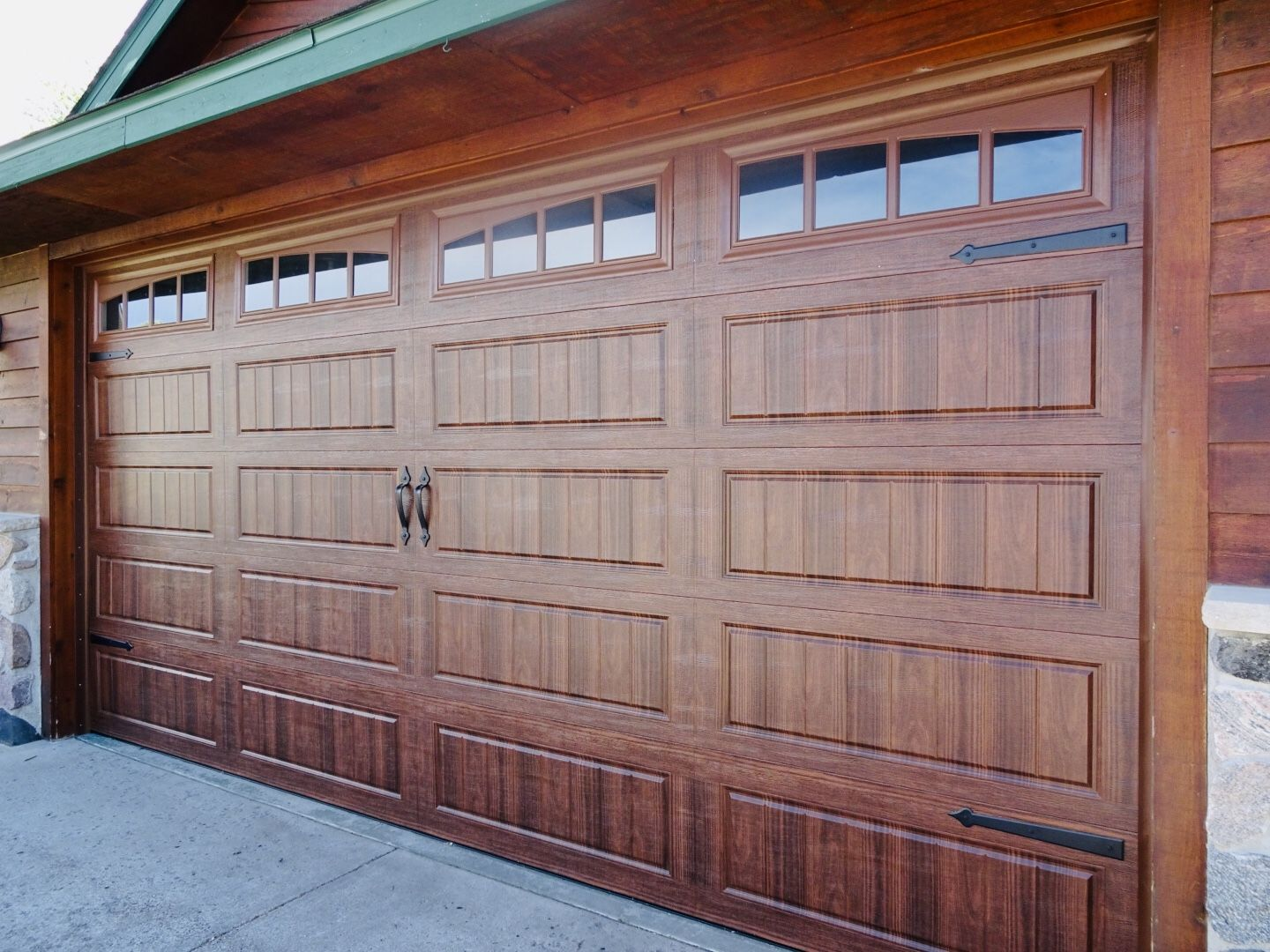 Amarr Hillcrest 3000 Garage Door In Walnut With Long Panel Bead Board And Arched Thames Windows Garage Doors Aluminium Garage Doors Garage Door Design
