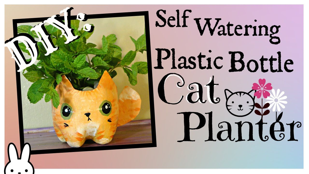 DIY: how to make a self watering plastic bottle kitty cat planter / tutorial How to turn trash into something adorable by making a self watering cat planter ...