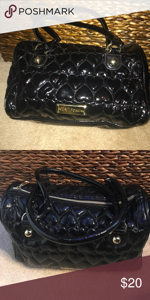 Betsy Johnson black purse Beset Johnson black purse with hearts embossed on outside Betsey Johnson Bags Satchels