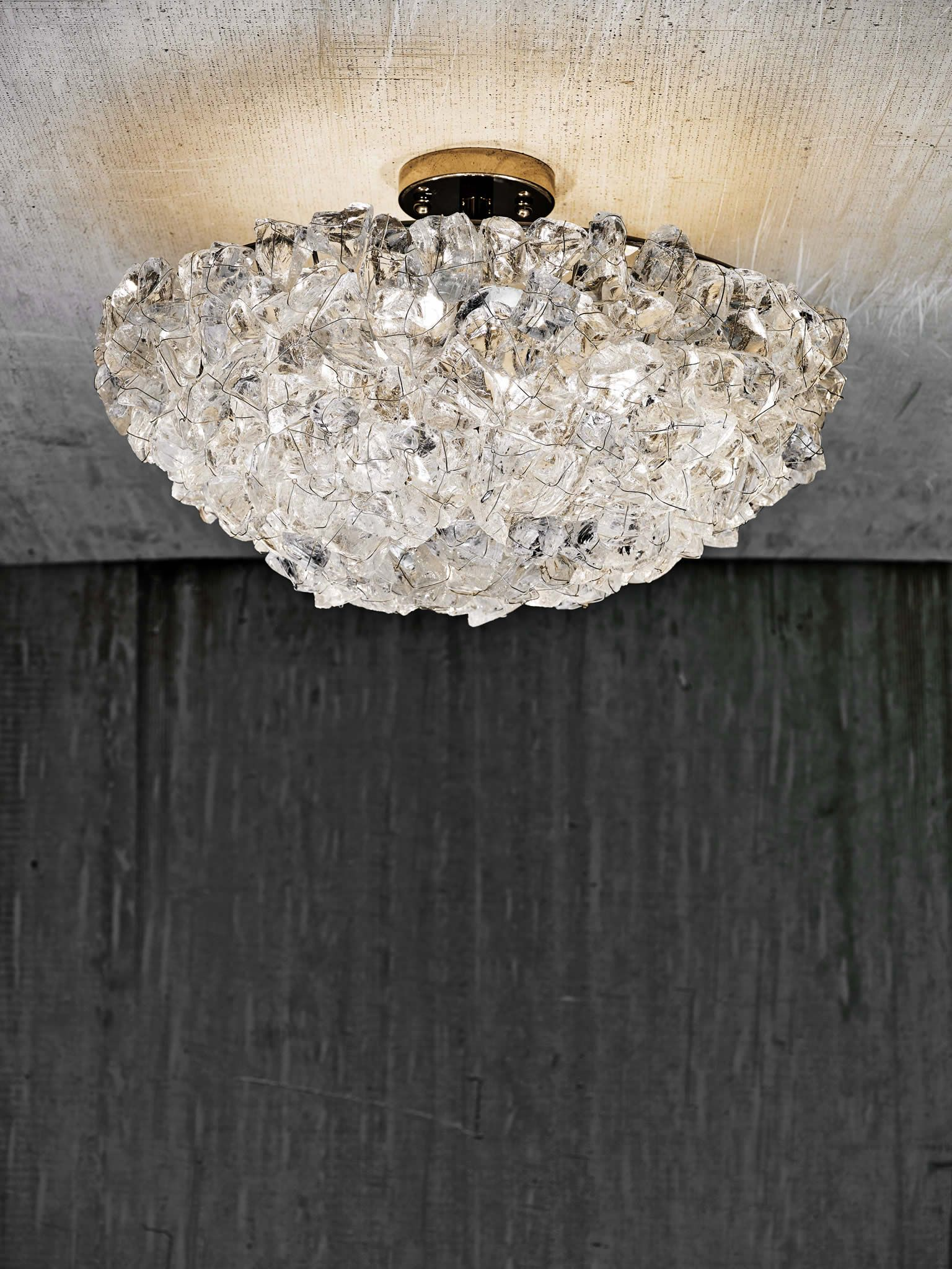 Rock crystal ceiling fixture rock crystal collection cl quartz and other natural stone accessories are making a big splash this year we can see why this quartz light fixture would add some major glam to any arubaitofo Gallery