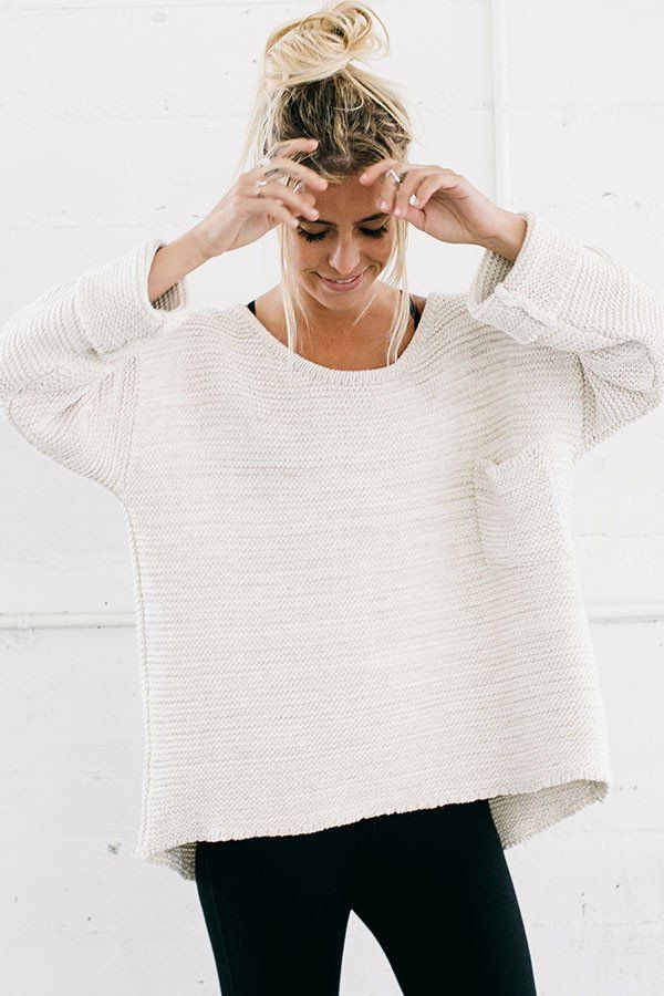 Oversized cropped pullover sweater in a chunky knit with pocket detail. An effortless wardrobe staple made from recycled materials. Color: Bone Size: One Size (0-10) Front Length: 24in Back Length: 27