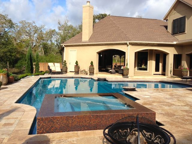 Pool, raised negative edge spa, glass tile. Tuscan Style for out ...