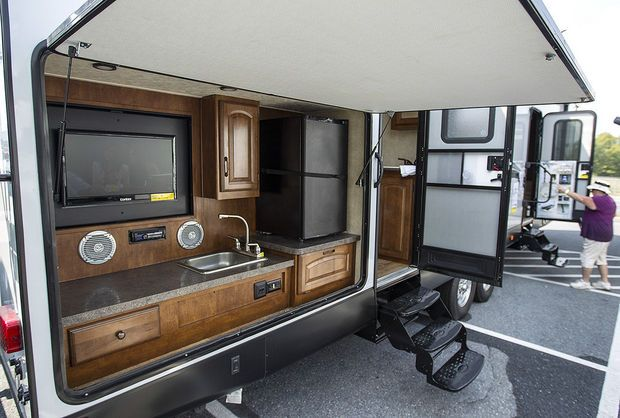 An Outdoor Entertainment Center And Kitchen Area Opens Up On The Enchanting Travel Trailer With Outdoor Kitchen Inspiration Design