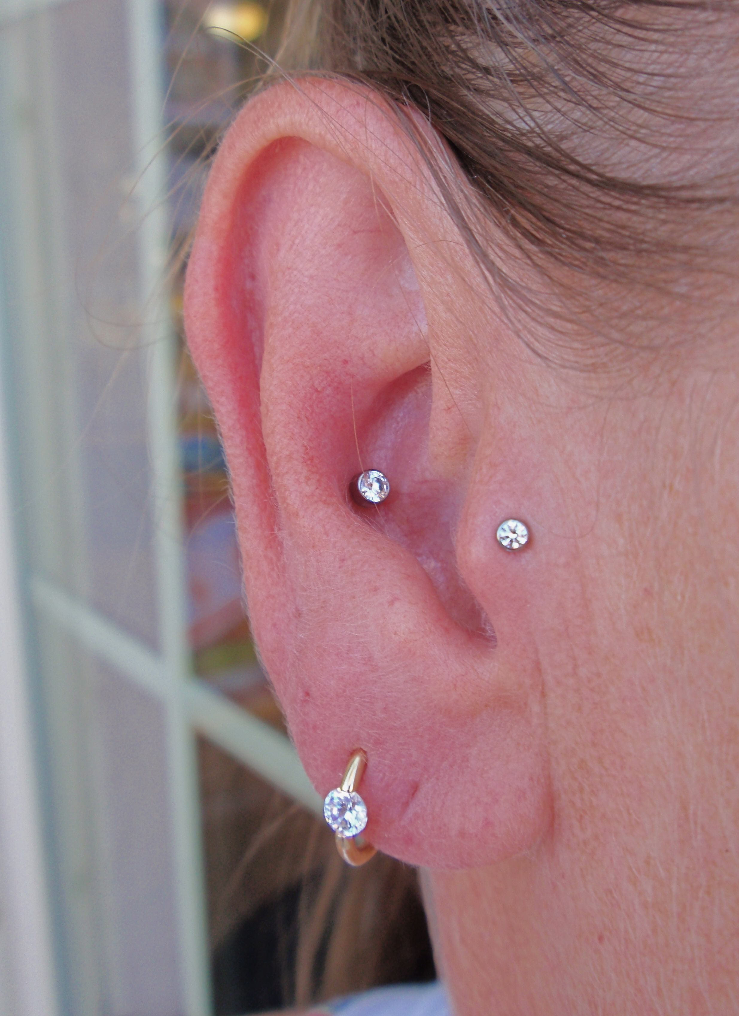 A Pic Of Two Piercings I Have The Tragus Closest To The Face Mine
