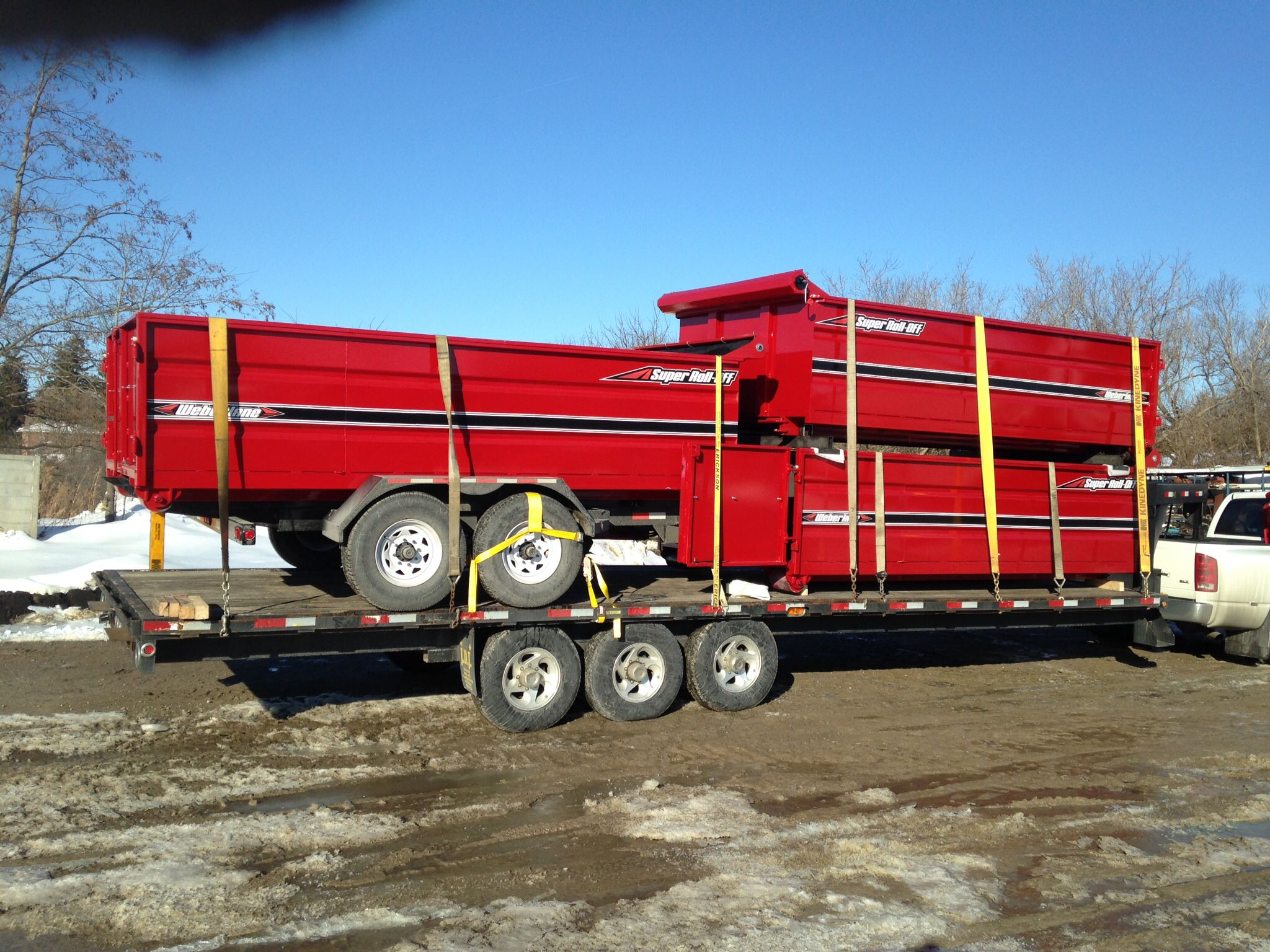 Super Roll Off Trailers stacked strapped & ready to roll