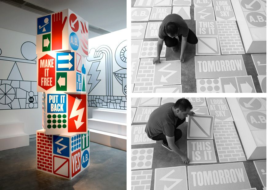 Large Scale Graphic Tower Made Of Four Metre Square Blocks Decorated With Vinyl Graphics Look At The Sky Environmental Graphics Typography Design