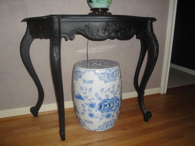 Remember...paint works wonders!  This was a dated pickled wood table, and black paint was a miracle worker.