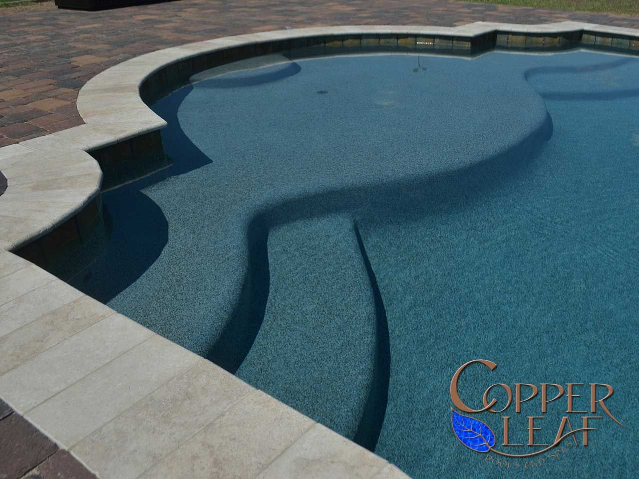 grecian pool large step on swimming pool with blue granite pebble sheen in phoenix - Rectangle Pool With Water Feature
