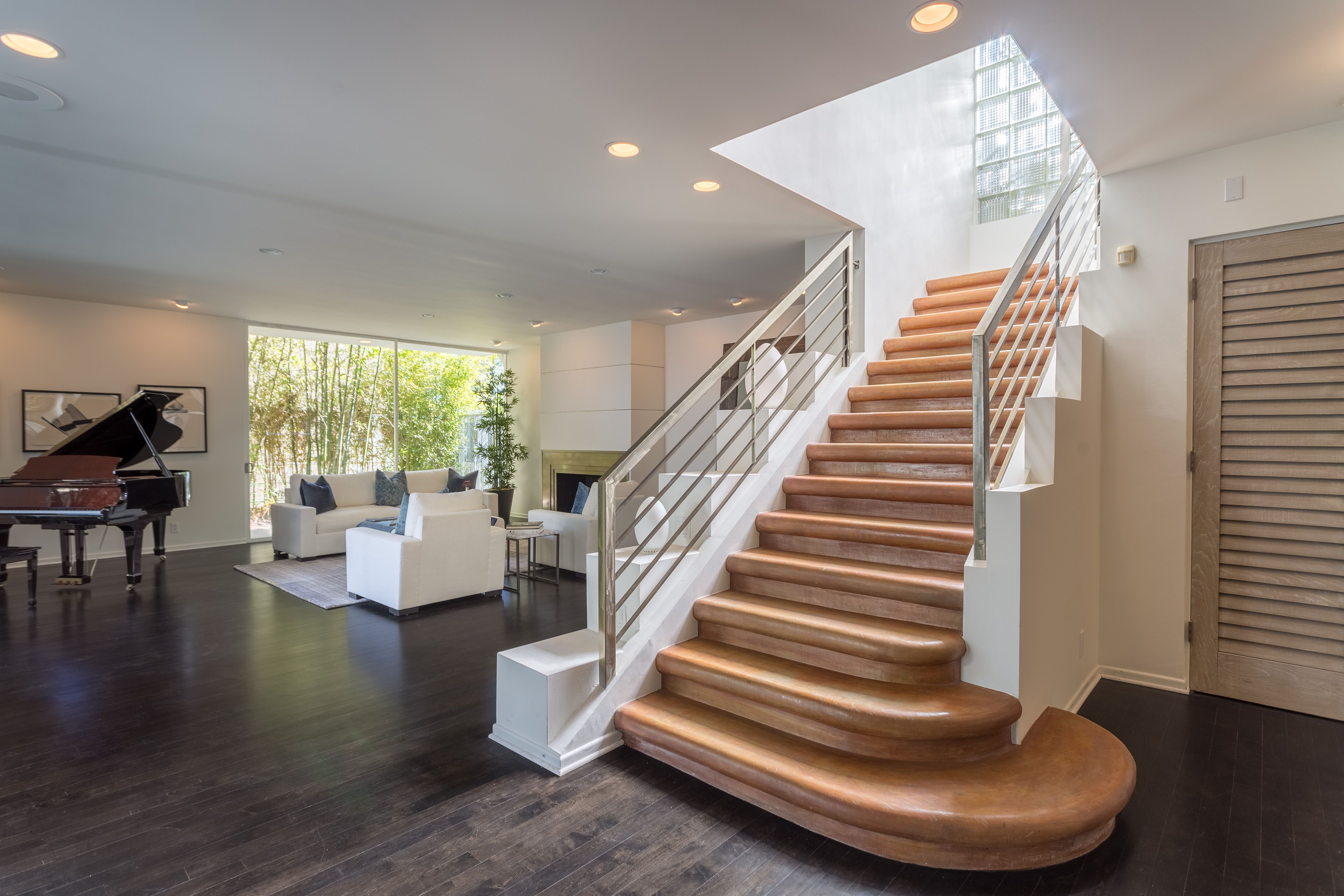 Staircase to second level where there are 2 bedroom suites