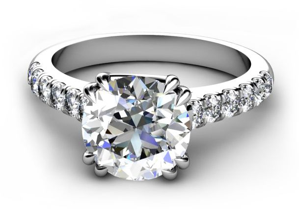 Double claw set round brilliant cut diamond engagement ring with
