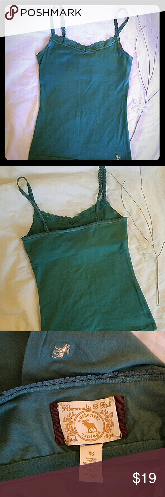 Abercrombie & Fitch tank top Beautiful turquoise tank top with silver metallic thread ditail and lace. Has a built-in bra. Size XS. Excellent condition! Abercrombie & Fitch Tops Tank Tops