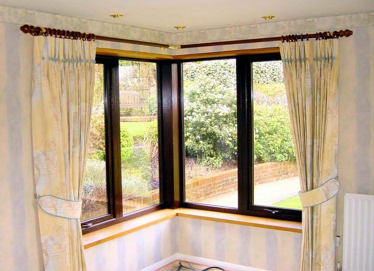 tied corner window curtains glass windows with black trims metal rods and rodu0027s rings