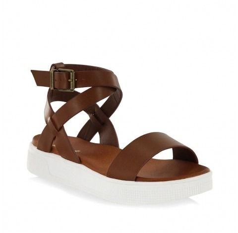 7378cb0a32c0 Have fun in the sun with the MIA Calla sneaker bottom sandal. Designed on a  thick rubber sole