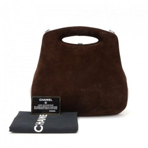 3868cd84021e Authentic Chanel dark brown suede leather hard case bag. Main access is  secured with push lock closure. Inside has fabric lining with lace detail  and three ...
