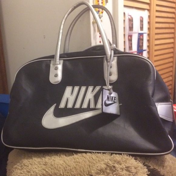 Nike leather bag Used but not abused. It is like a bowling bag. Nike Bags  Travel Bags 33fdf257e3204