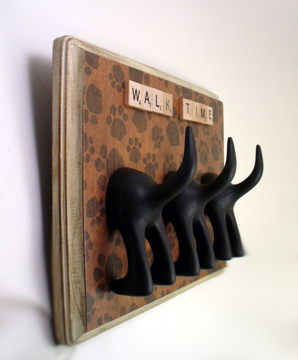 Dog Leash Holder - great idea for front door, already have the doggie butts, too! (from Etsy)