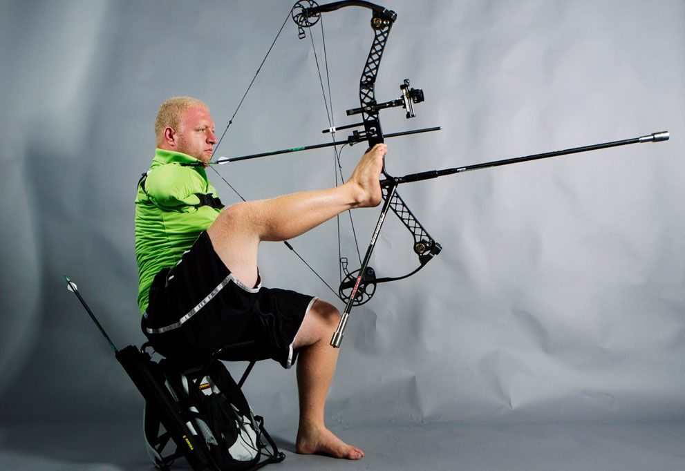 #Paralympics archer Matt Stutzman uses his feet to hold and aim his bow while demonstrating his archery technique in New York, on June 13, 2012. Stutzman, who was born without arms, will be representing the U.S. in the upcoming 2012 Paralympic Games in London. (Reuters/Lucas Jackson)