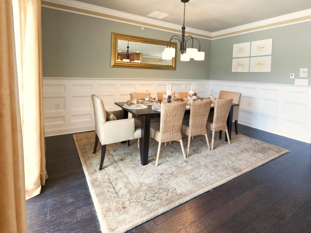 White Crown Molding And Wainscoting Give An Air Of Formality To This Sage Green Dining Room A Neutral Area Rug Ties Together The Transitional Beige Chairs