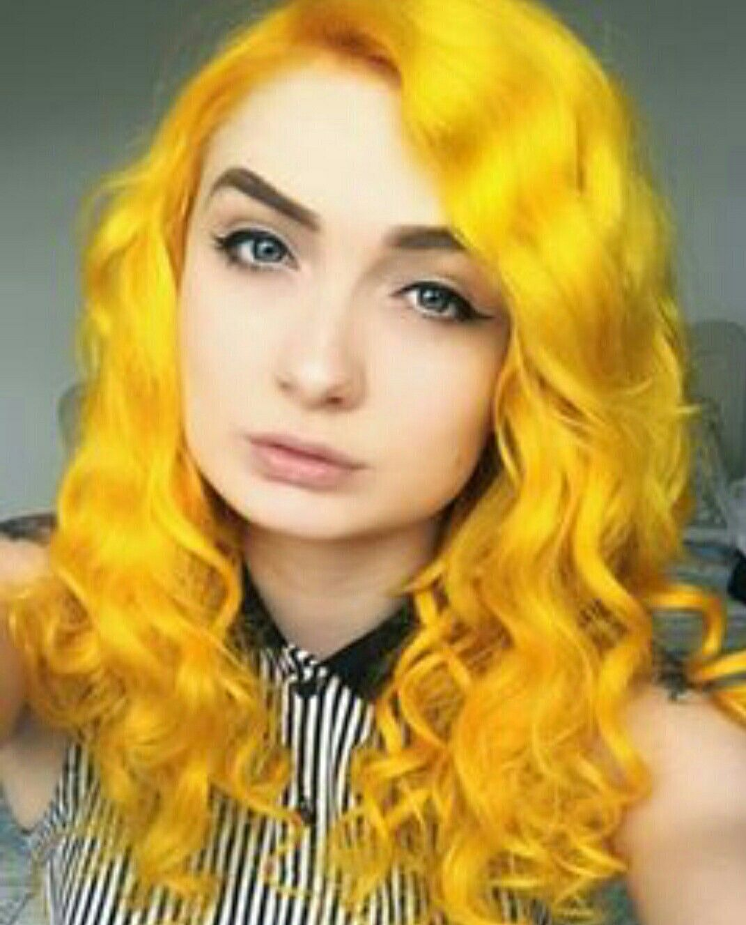Cliphair extensions dyed into vibrant yellow colour love this big