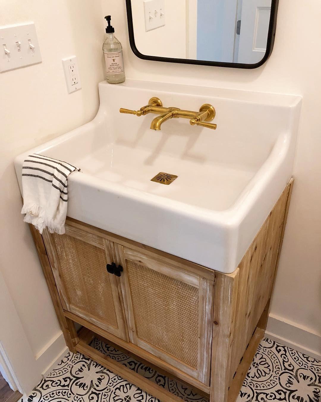 Half bath with printed tile farm sink wall mounted