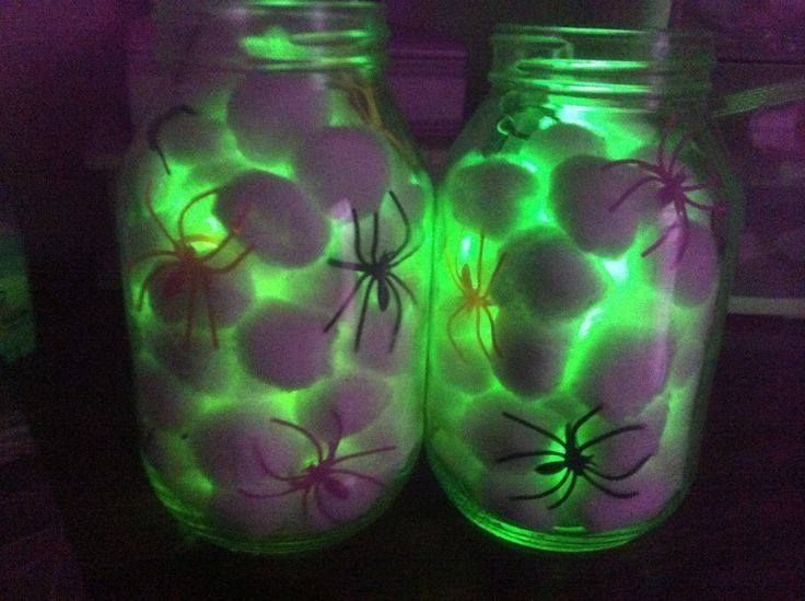 All you need is some cotton balls, a mason jar, some dollar store spiders, and a glow stick.