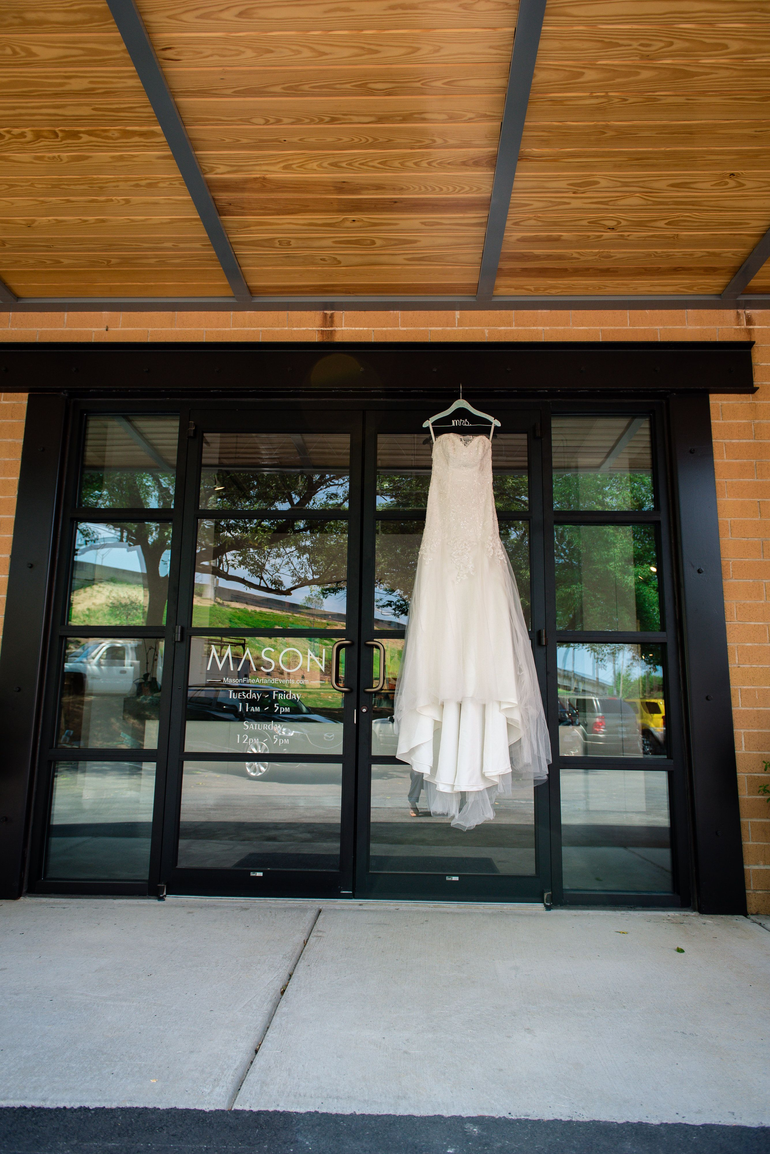 The front door to mason fine art on wedding day photo by by design