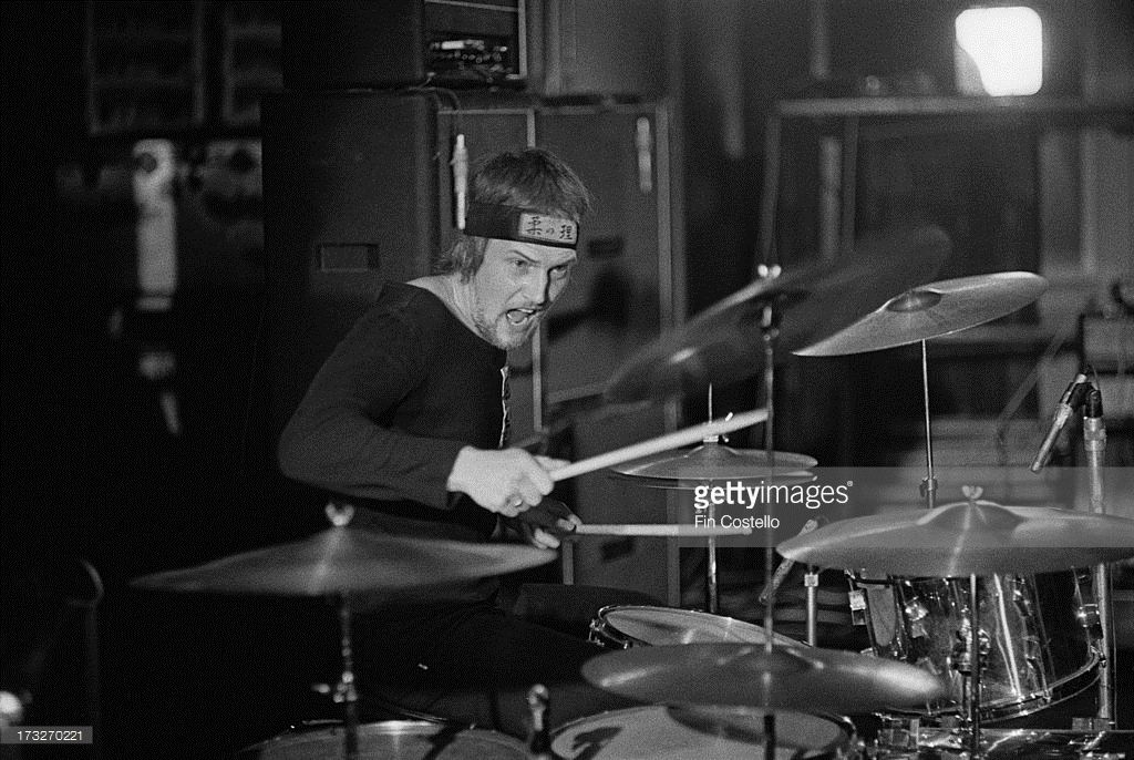 Drummer Chris Slade performs live on stage with Manfred Mann's Earth Band at Westfield College in North London in November 1973.