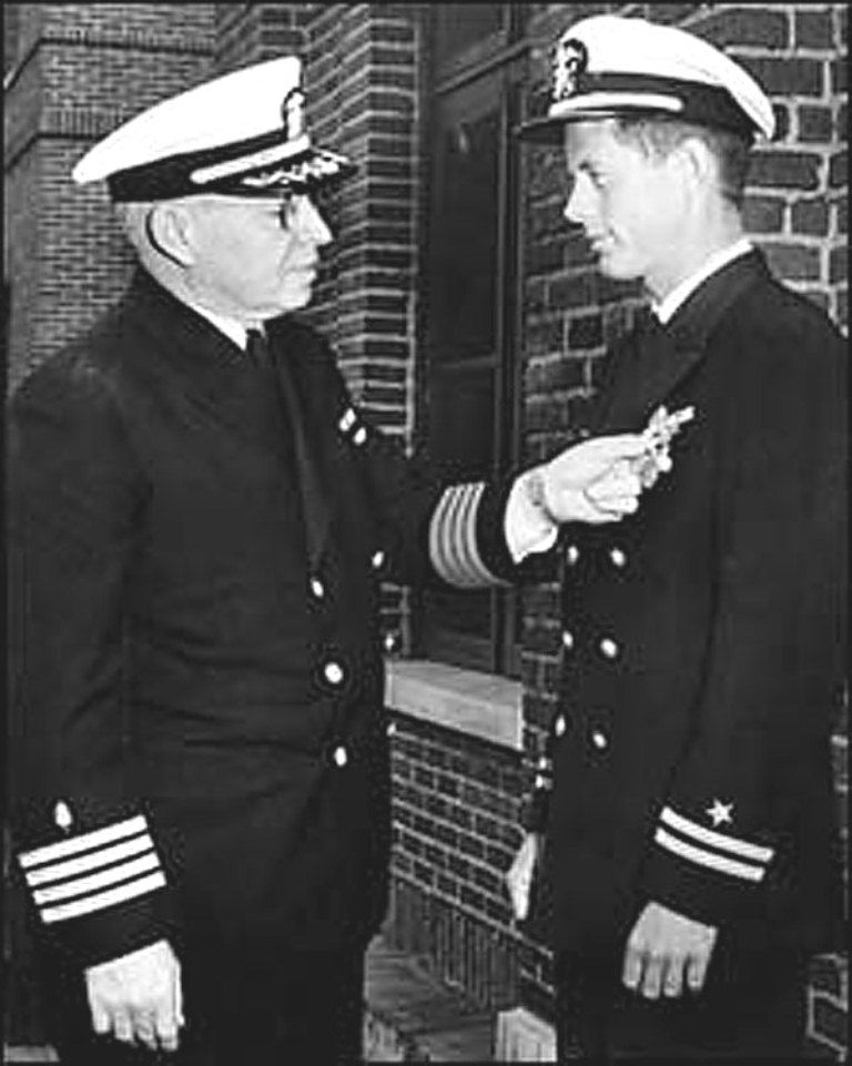 Lt. Kennedy in naval uniform receiving the Navy and Marine Corps ...