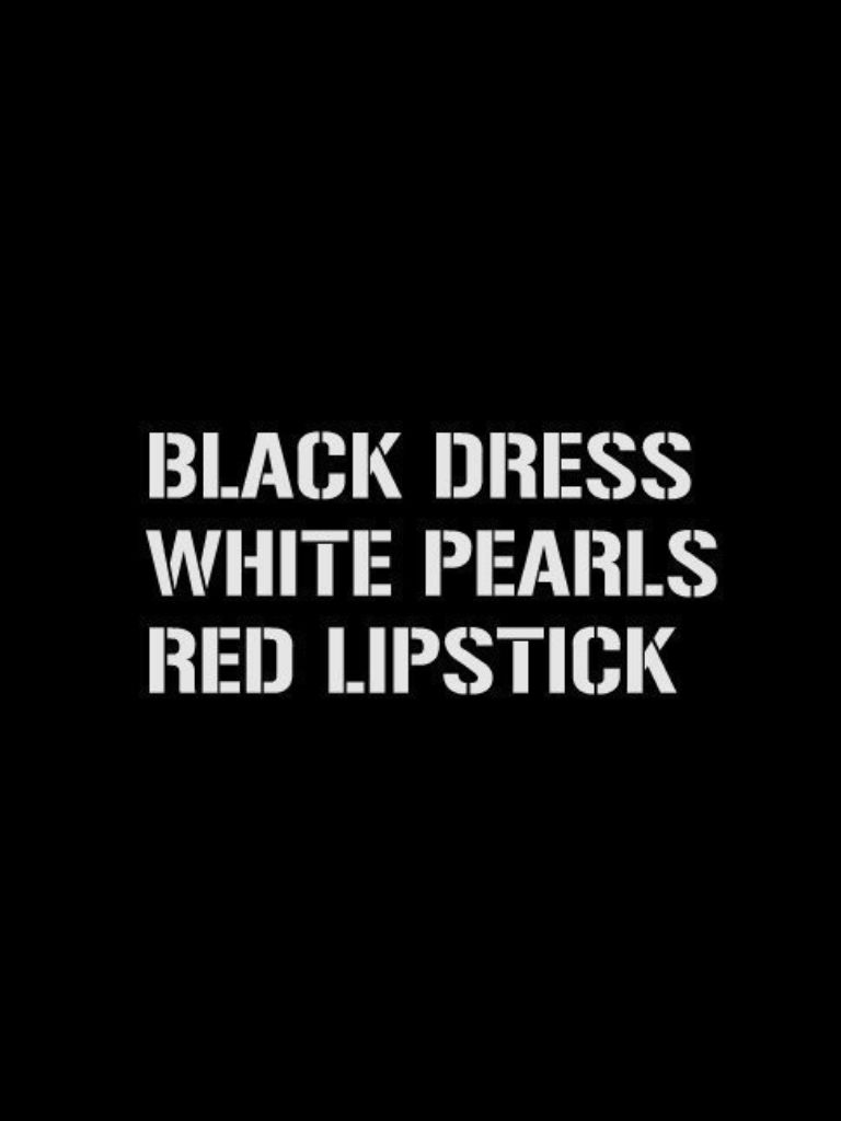Black dress white pearls red lipstick