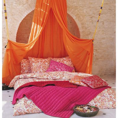 Moroccan Bed Canopy looks easy; mount a u-shaped curtain rod over the head of the bed