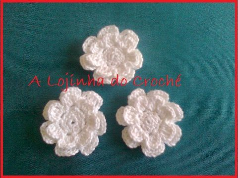 These 3 crocheted flowers were ordered to decorate a girl's first communion dress.