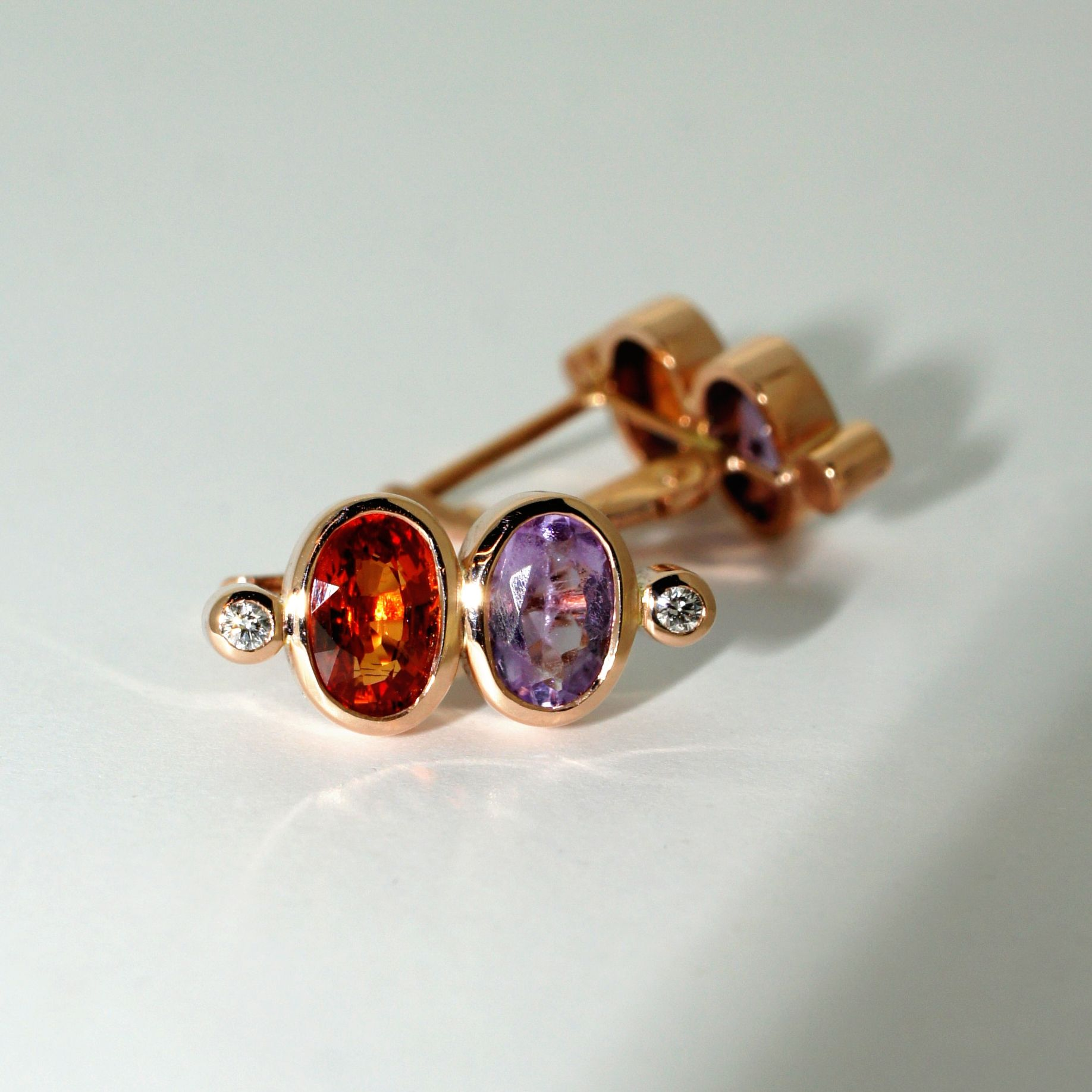 A look back at these contemporary earrings handcrafted in rose gold and set with orange sapphires, amethysts and diamonds.          #gemstoneearrings #rosegoldearrings #amethyst #orangesapphire #contemporaryearrings #customjewellery #bespokejewellery #earrings #handmadejewellery #contemporaryjewellery #jewellery #sydneyjeweller #sydneyjewellerydesigner #australianjeweller #jewelry