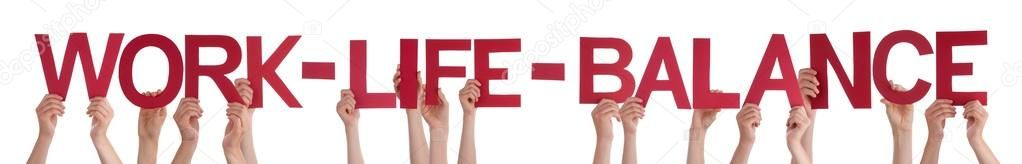 Hands holding red straight word work life balance stock