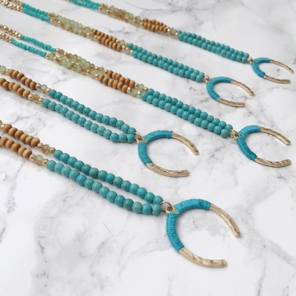 """Crescent Gypsy Necklace Complete your look with this stunning  Crescent Gypsy necklace! Made with wood and glass seed beads and a thread wrapped crescent pendant. The beautiful turquoise color makes for a nice pop.   28"""" in length Twilight Gypsy Collective Jewelry Necklaces"""