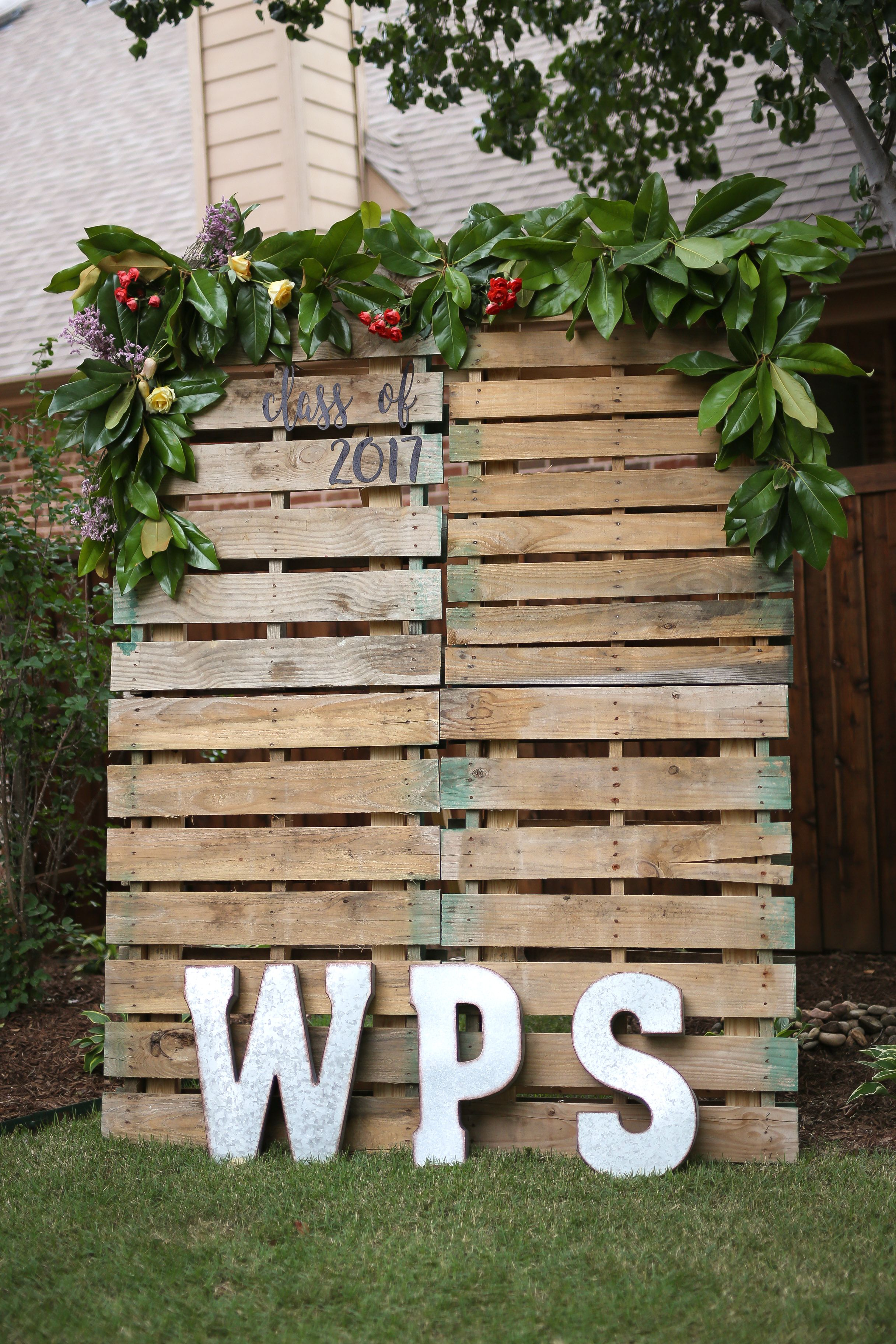 Pallet photo backdrop with magnolia leaves | Graduation ...