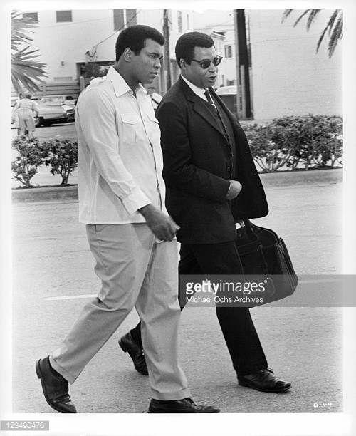 muhammad ali walks with james earl jones in a scene from