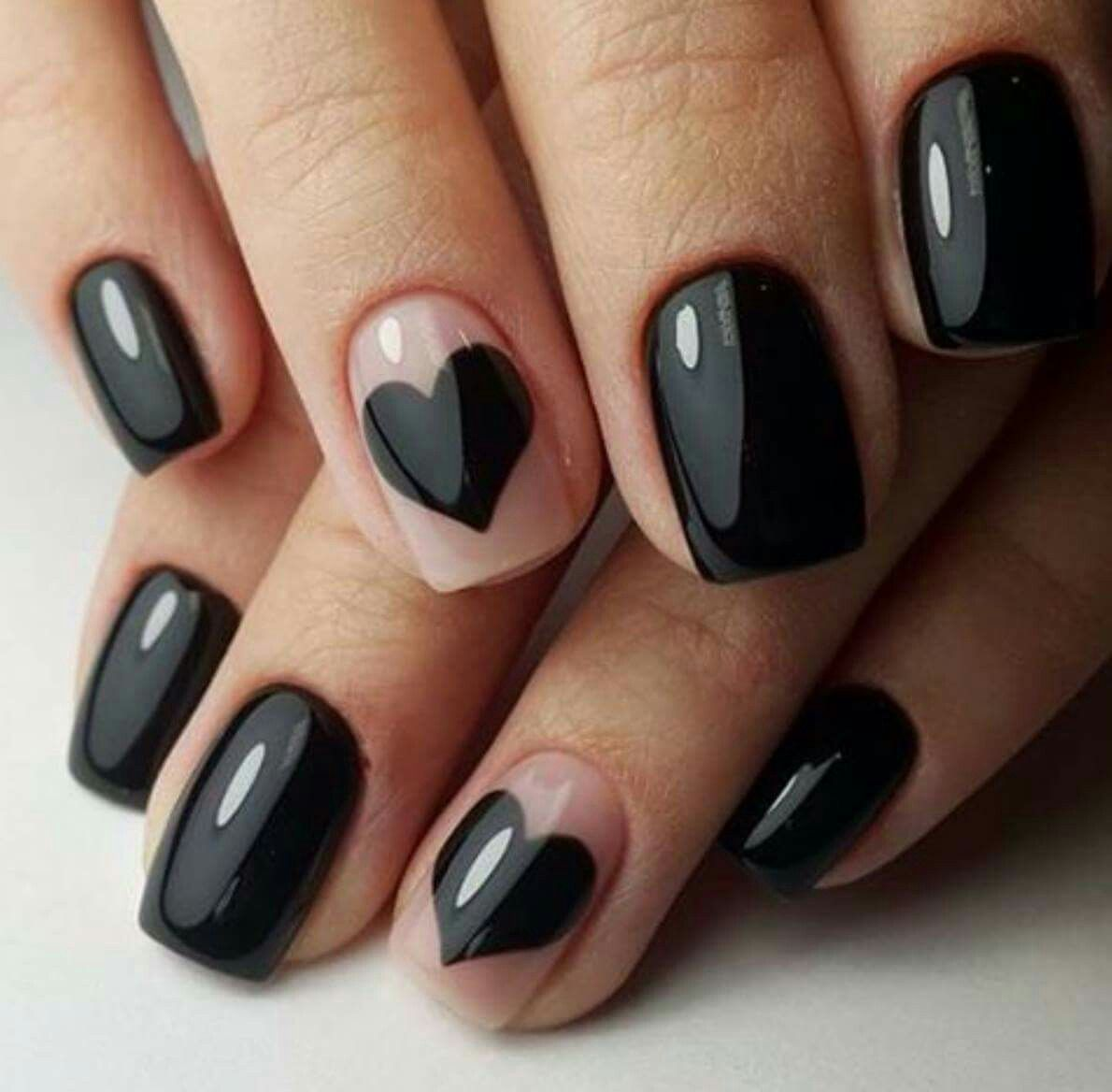 Black beauty nails with black hearts on one finger on each hand