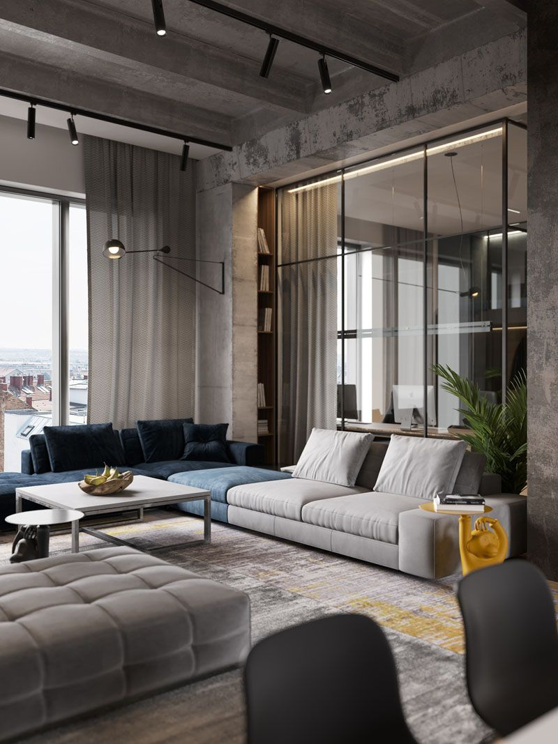 A Glass Wall Separates The Living Room From The Home Offic