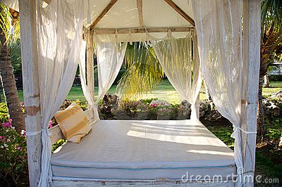 photo about tropical canopy bed in gardens 8358575